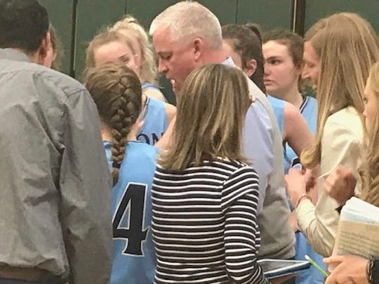 The Great Falls High Bison girls gather around head coach Jerry Schmitz during a timeout during the first round of the Eastern AA Divisionals Thursday at the CMR Fieldhouse.