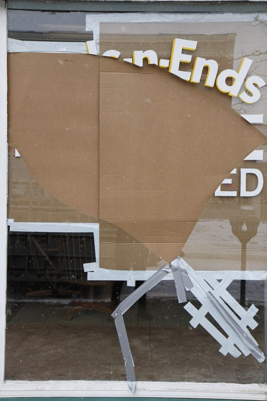 Once of the front windows of the store was broken after the collapse of the awning.