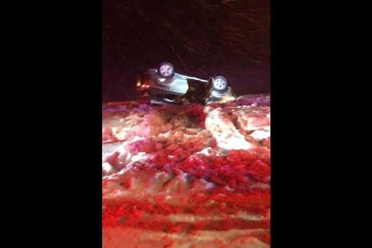 Airmen rescue motorist in flipped car during snowstorm