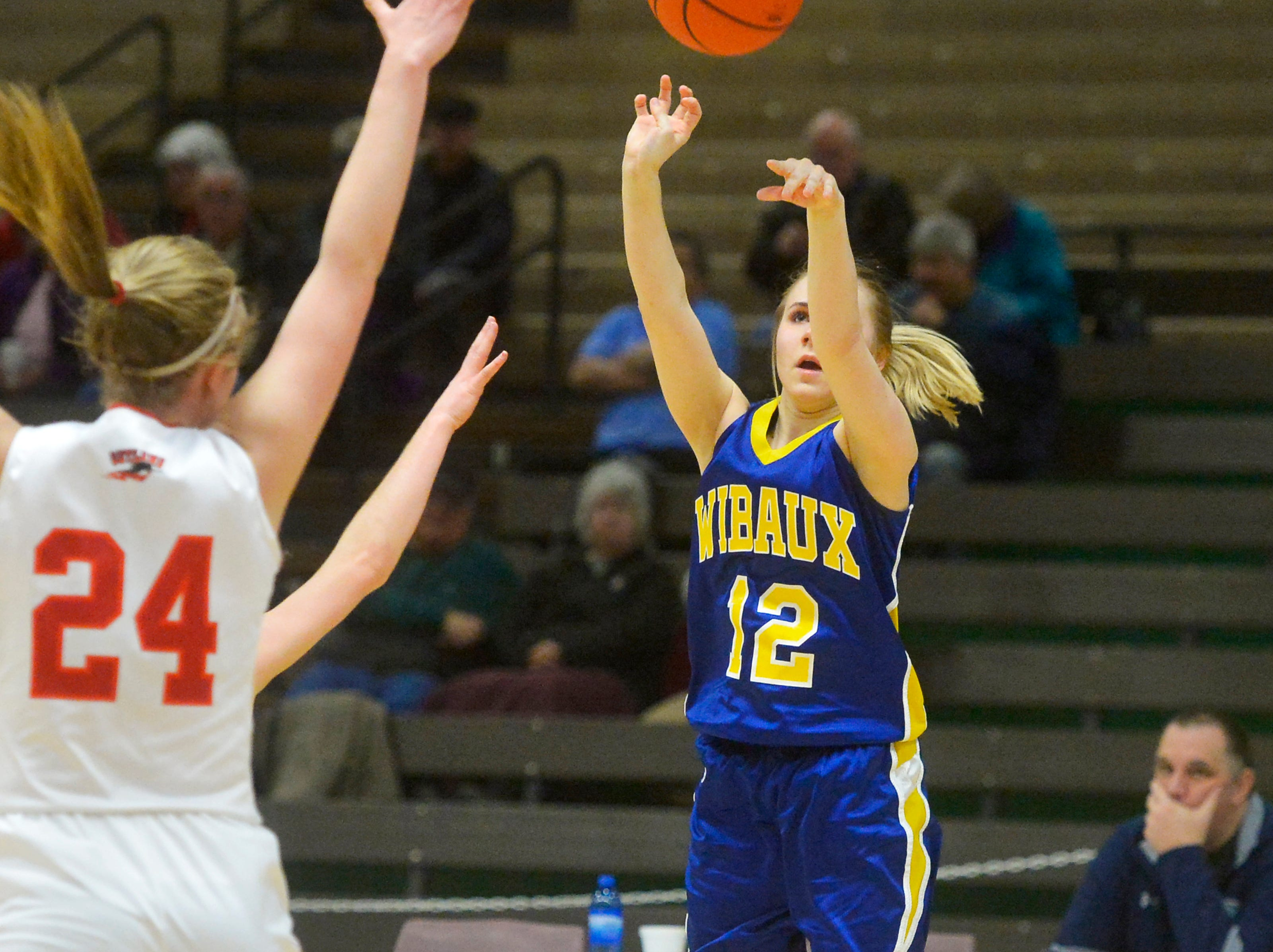 Wibaux's Ceara Miske shoots a three pointer in Thursday's game against Roy-Winifred during the Girls State C Basketball Tournament in the Four Seasons Arena.