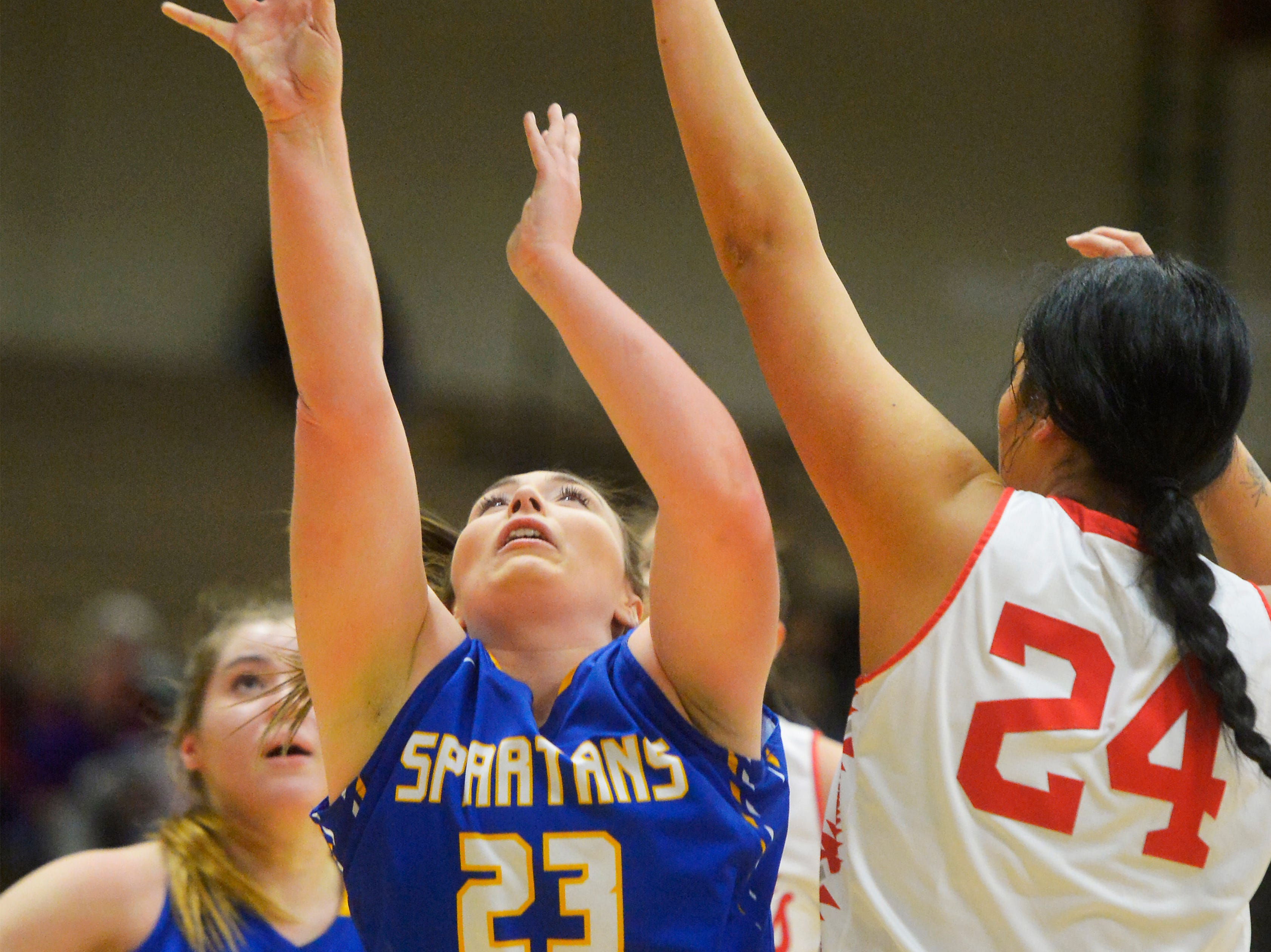 Scobey's ShaAnn Danelson attempts a shot as Alyssia Vanderburg defends during the Girls State C Basketball Tournament on Thursday in the Four Seasons Arena.
