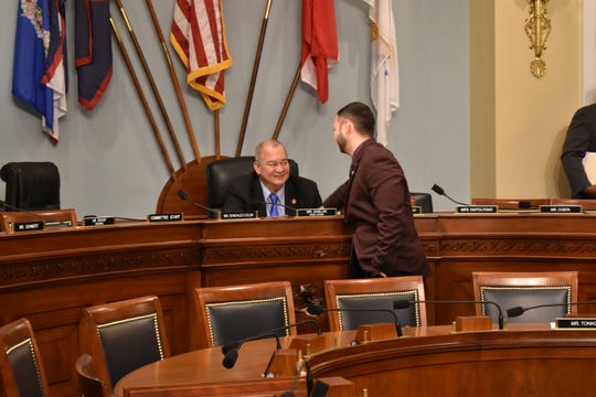 CNMI Del. Gregorio Kilili Sablan and Guam Del. Mike San Nicolas confer on Wednesday during a U.S. House Natural Resources Committee hearing on the impact of limited access to H-2B workers and a CNMI-only immigration status bill.