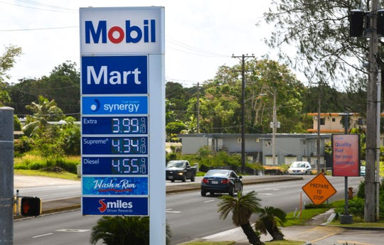 Motorists drive pass a sign indicating an increase of fuel costs at the Mobil Mart gas station in Sinajana on Thursday, Feb. 28, 2019. Ten cents has been added to the price of Extra grade fuel, an increase from $3.89 to $3.99. Historically, when one gas station on Guam raises or lowers prices, other fuel providers usually follow suit, within a day or two.