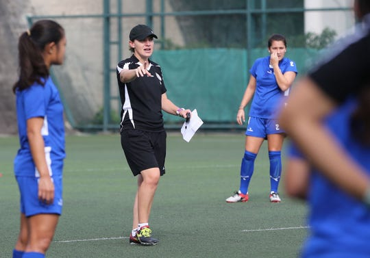 Guam Football Association Technical Director Belinda Wilson directs a training session with the Masakåda in the 2017 EAFF E-1 Football Championship Round 2 tournament in Hong Kong in this file photo.