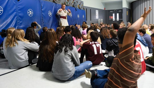 Students, eager with questions, listen to Cherokee storyteller and historian Anthony Martin during a program on Native American culture at Henderson's East Heights Elementary School Wednesday, February 27, 2019