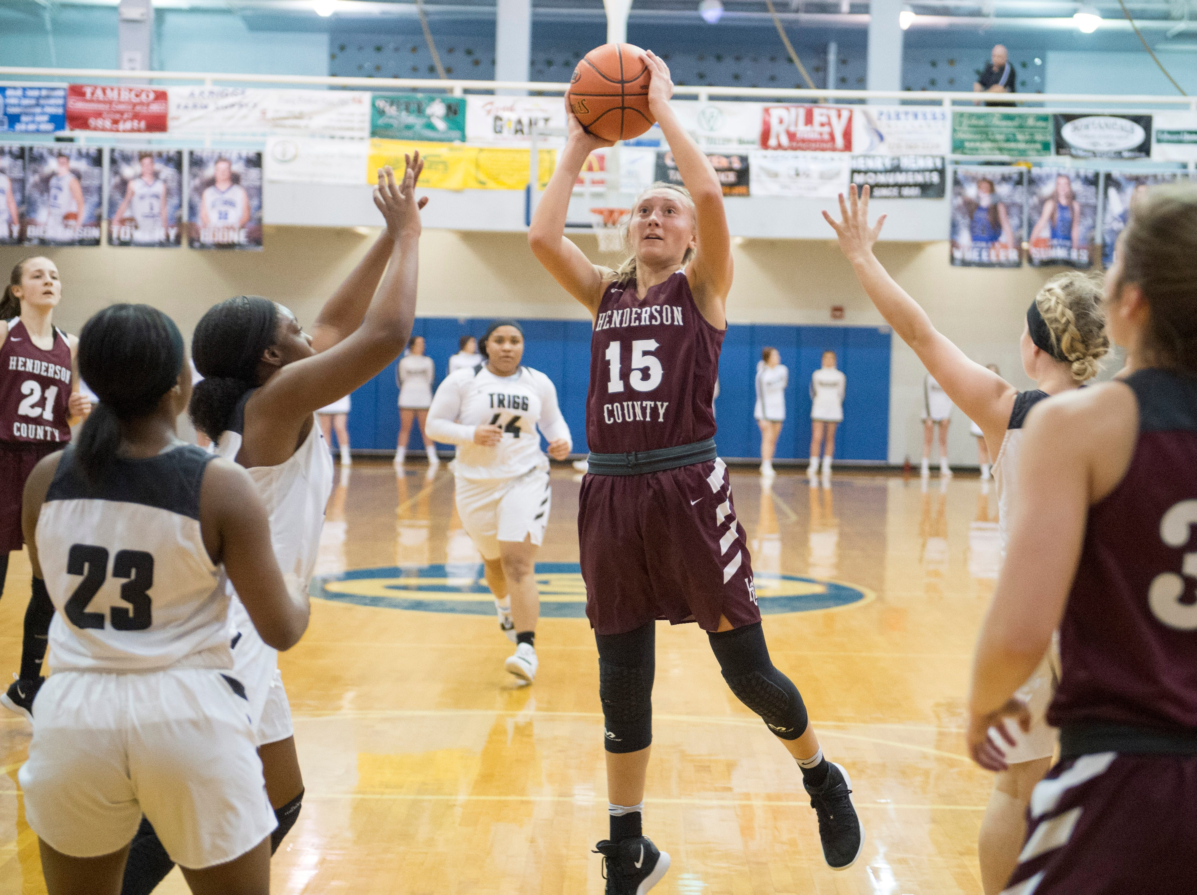 Henderson County's Alyssa Dickson (15) takes a shot during the Trigg County Lady Wildcats vs Henderson County Lady Colonels game of the 2nd Region Tournament at Crittenden County's Rocket Arena Wednesday, Feb. 27, 2019.
