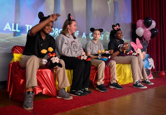 South Middle School eighth graders, left to right, Montrey Griffin, Keylan Stone, Alyssa Maehara and JaBria Wilson react after being chosen to go on the Cops Connecting with Kids trip to the Magic Kingdom Wednesday. In total eight students from Henderson's middle schools were chosen based on grades, effort, staying out of trouble and leadership skills, February 27, 2019.