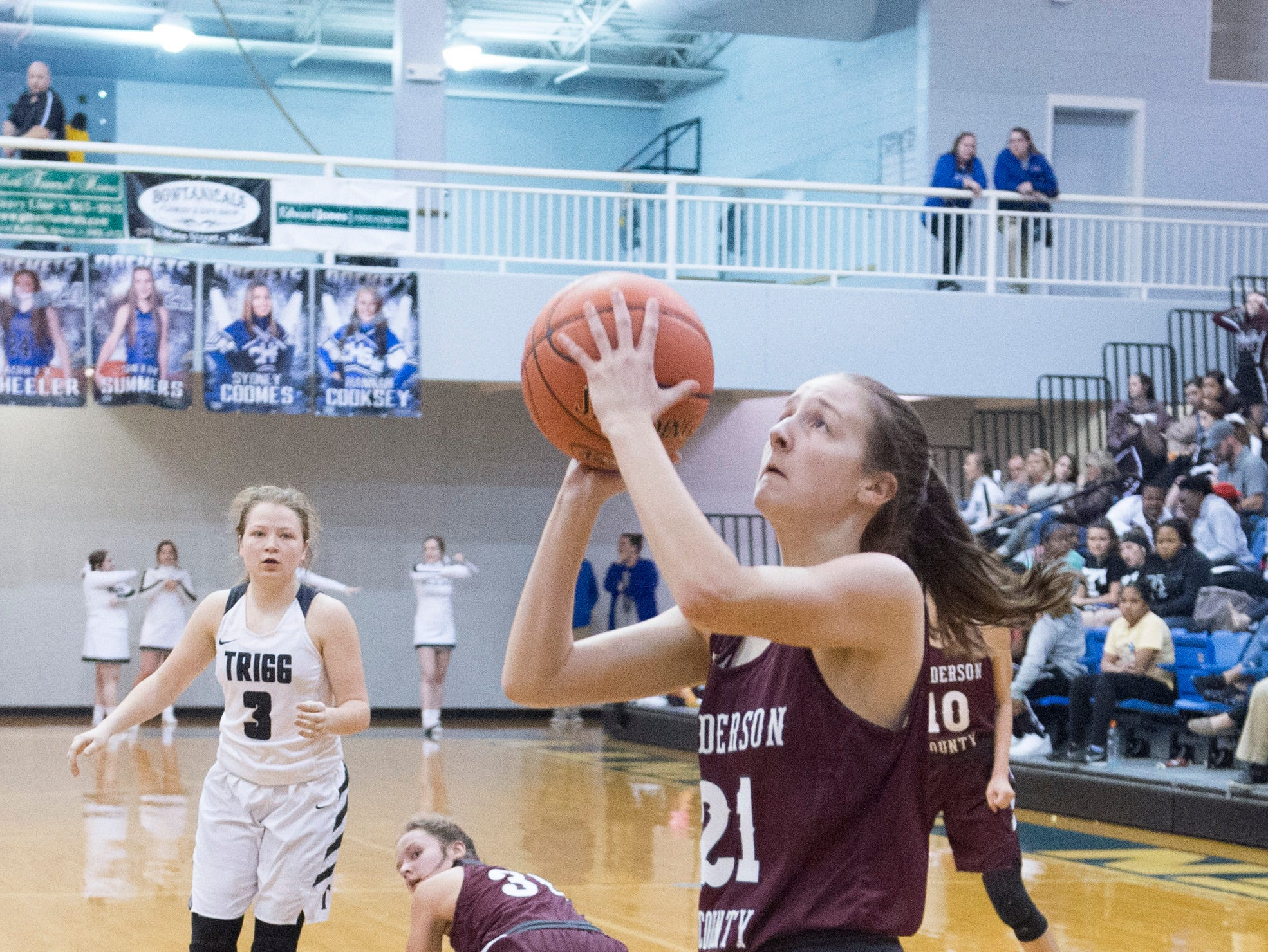 Henderson County's Graci Risely (21) takes a shot during the Trigg County Lady Wildcats vs Henderson County Lady Colonels game of the 2nd Region Tournament at Crittenden County's Rocket Arena Wednesday, Feb. 27, 2019.