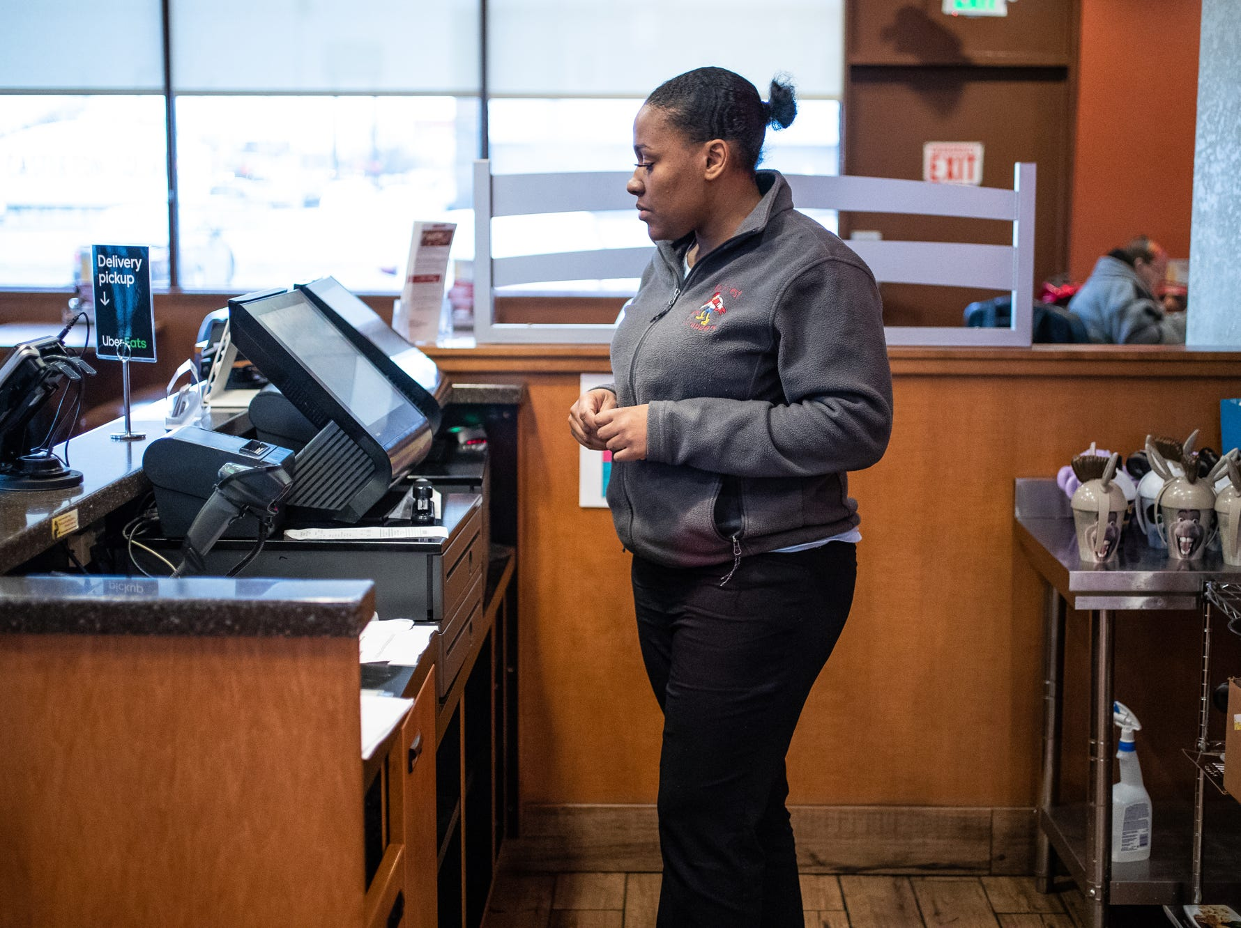 Latasha Sanders helps an employee enter a promo into the cash register for a customer at the Denny's off E. 82nd Street in Indianapolis on Tuesday, Feb. 19, 2019. Sanders is a shift manager at the location.