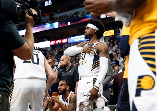 Indiana Pacers guard Wesley Matthews (23) places his hand over his heart as he acknowledges cheers from fans in the first half of an NBA basketball game against the Dallas Mavericks in Dallas, Wednesday, Feb. 27, 2019. The game was Matthews' first in Dallas since being traded away. (AP Photo/Tony Gutierrez)