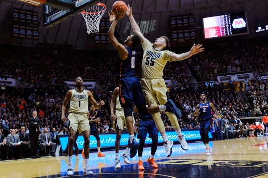 Purdue guard Sasha Stefanovic (55) fouls Illinois guard Alan Griffin (0) during the first half of an NCAA college basketball game in West Lafayette, Ind., Wednesday, Feb. 27, 2019. (AP Photo/AJ Mast)