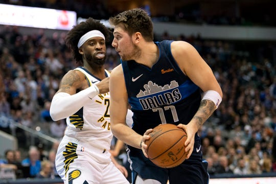 Feb 27, 2019; Dallas, TX, USA; Indiana Pacers guard Wesley Matthews (23) pressures Dallas Mavericks forward Luka Doncic (77) during the second quarter at the American Airlines Center.