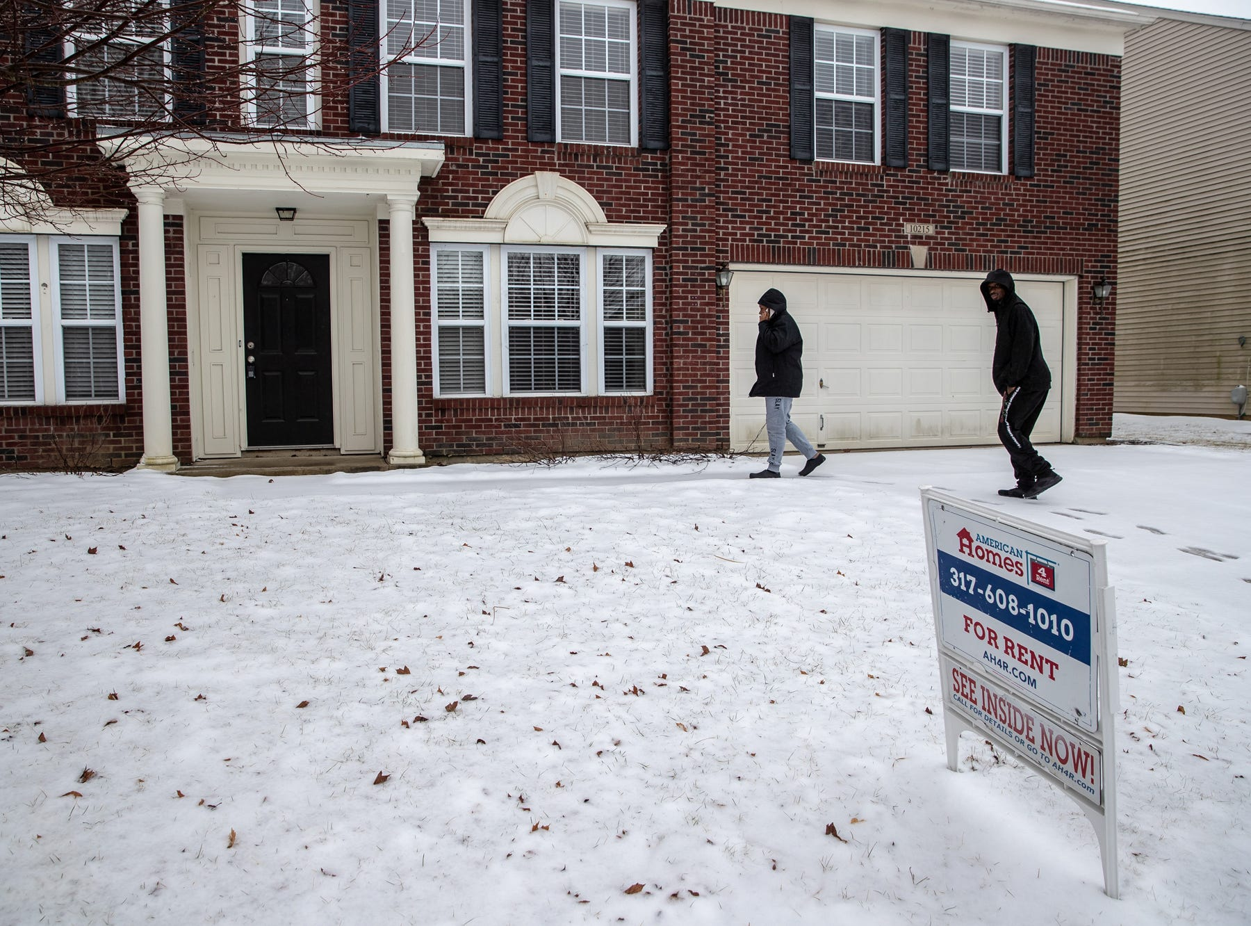 Latasha Sanders and her husband, Charles, make their way up to the door of a home for rent near Brownsburg, Ind., on Wednesday, Feb. 20, 2019. Latasha speaks to the man who claims he owns the home on the phone.