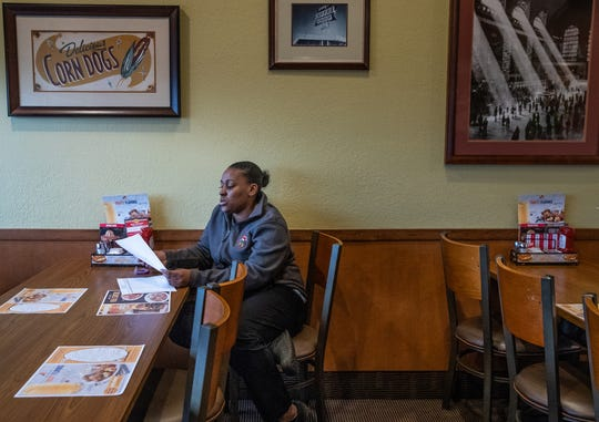 Latasha Sanders looks through a data sheet while working at the Denny's off E. 82nd Street in Indianapolis on Tuesday, Feb. 19, 2019. Sanders is a shift manager at the location.