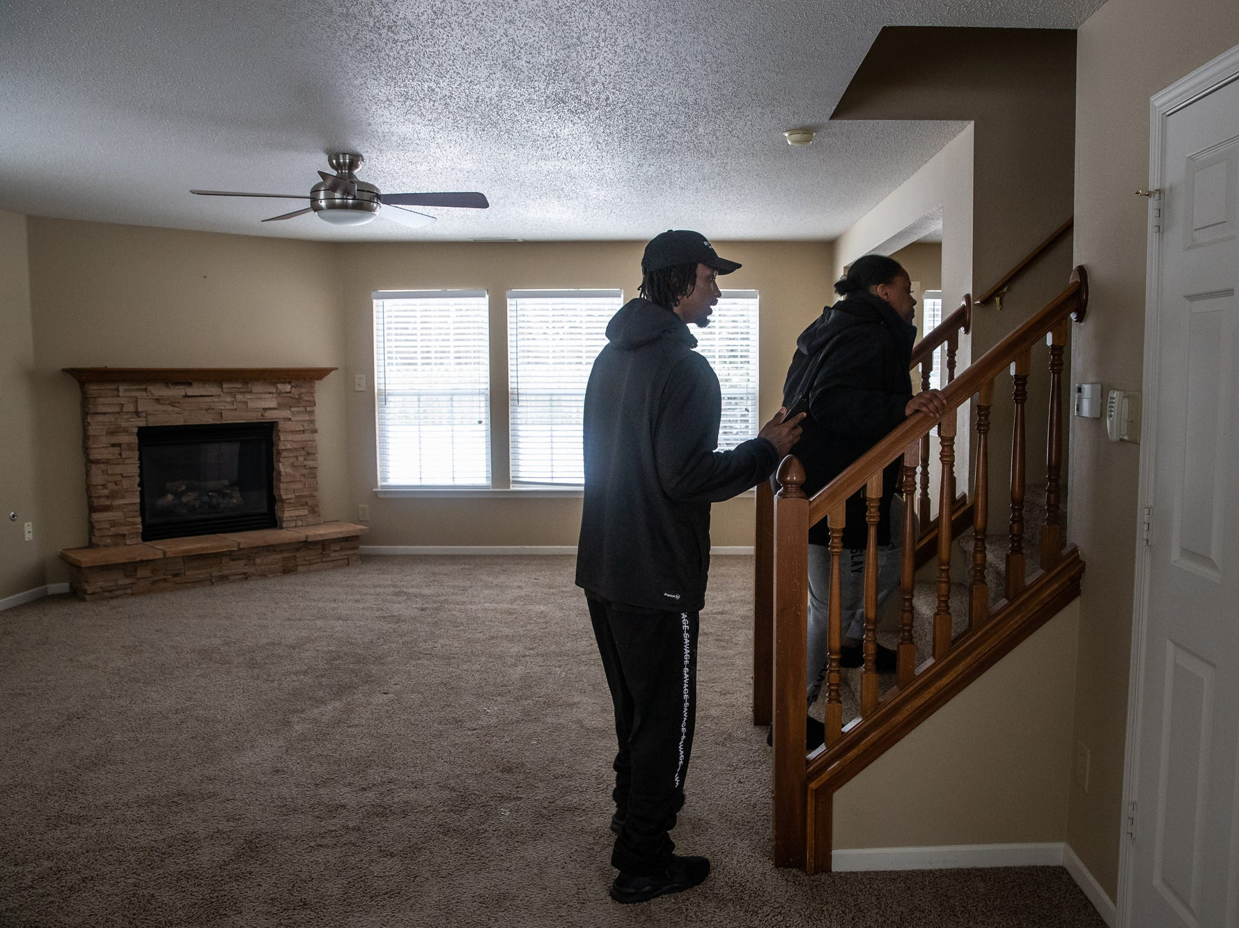 """Charles and Latasha Sanders walk up to the second story of a home for rent in the Brownsburg, Ind., area on Wednesday, Feb. 20, 2019. """"It's like a dream home,"""" said Charles. """"I mean this is what everybody want, a house like this."""""""