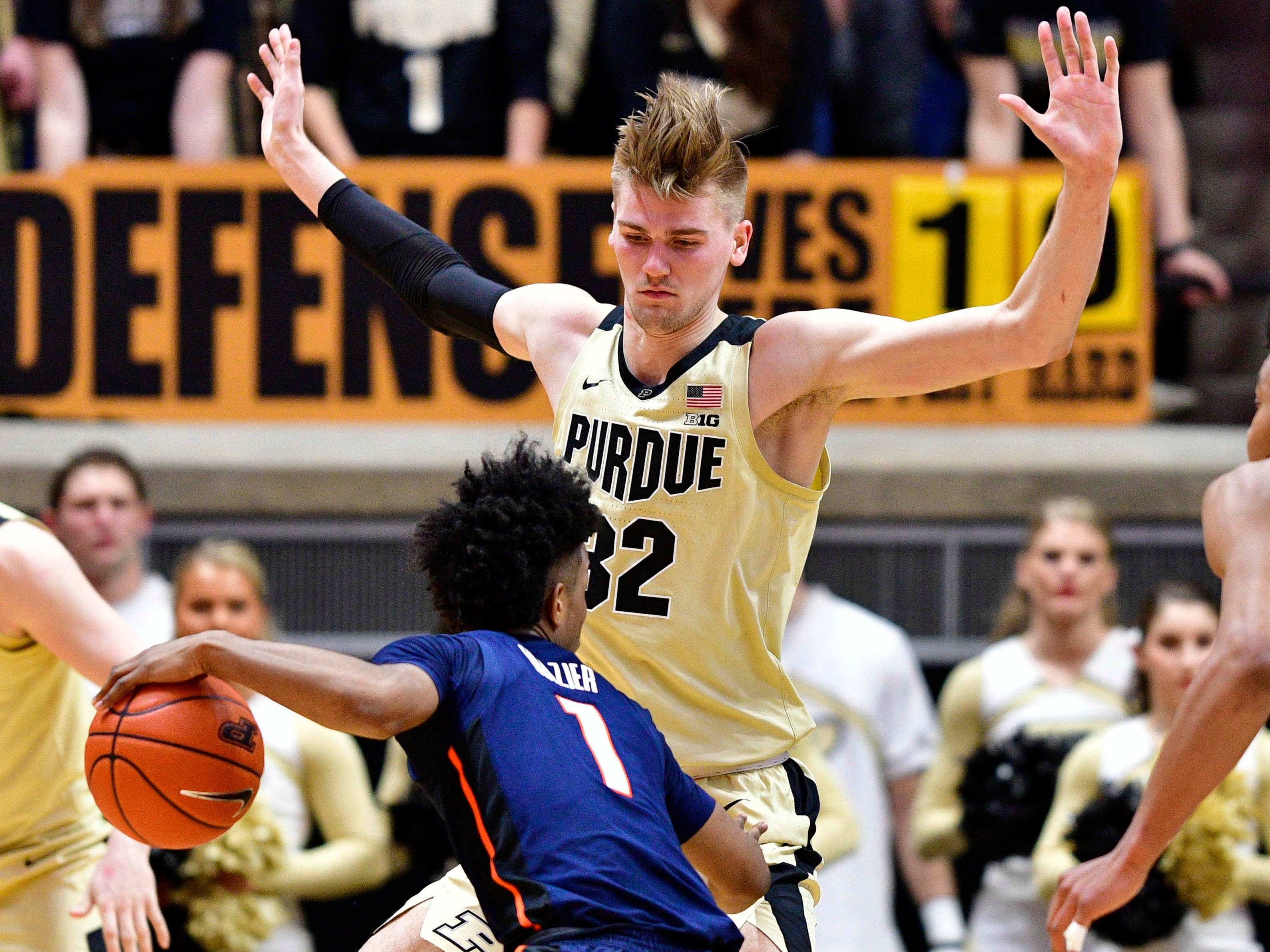Feb 27, 2019; West Lafayette, IN, USA; Purdue Boilermakers center Matt Haarms (32) guards Illinois Fighting Illini guard Trent Frazier (1) during the second half of the game at Mackey Arena. The Purdue Boilermakers defeated the Illinois Fighting Illini 73 to 56.