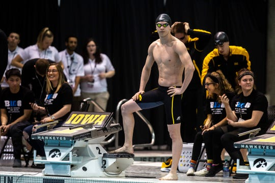 Iowa freshman Aleksey Tarasenko gets ready before the 800 yard freestyle relay during the first day of Big Ten men's swimming and diving championships on Wednesday, Feb. 27, 2019, at the Campus Recreation and Wellness Center (CRWC) in Iowa City, Iowa.