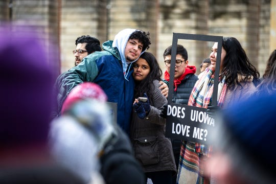 "Students gather during a ""speak out"" event organized by the ""#DoesUIowaLoveMe"" group on Thursday, Feb. 28, 2019, along the T. Anne Cleary Walkway on the University of Iowa campus in Iowa City, Iowa."