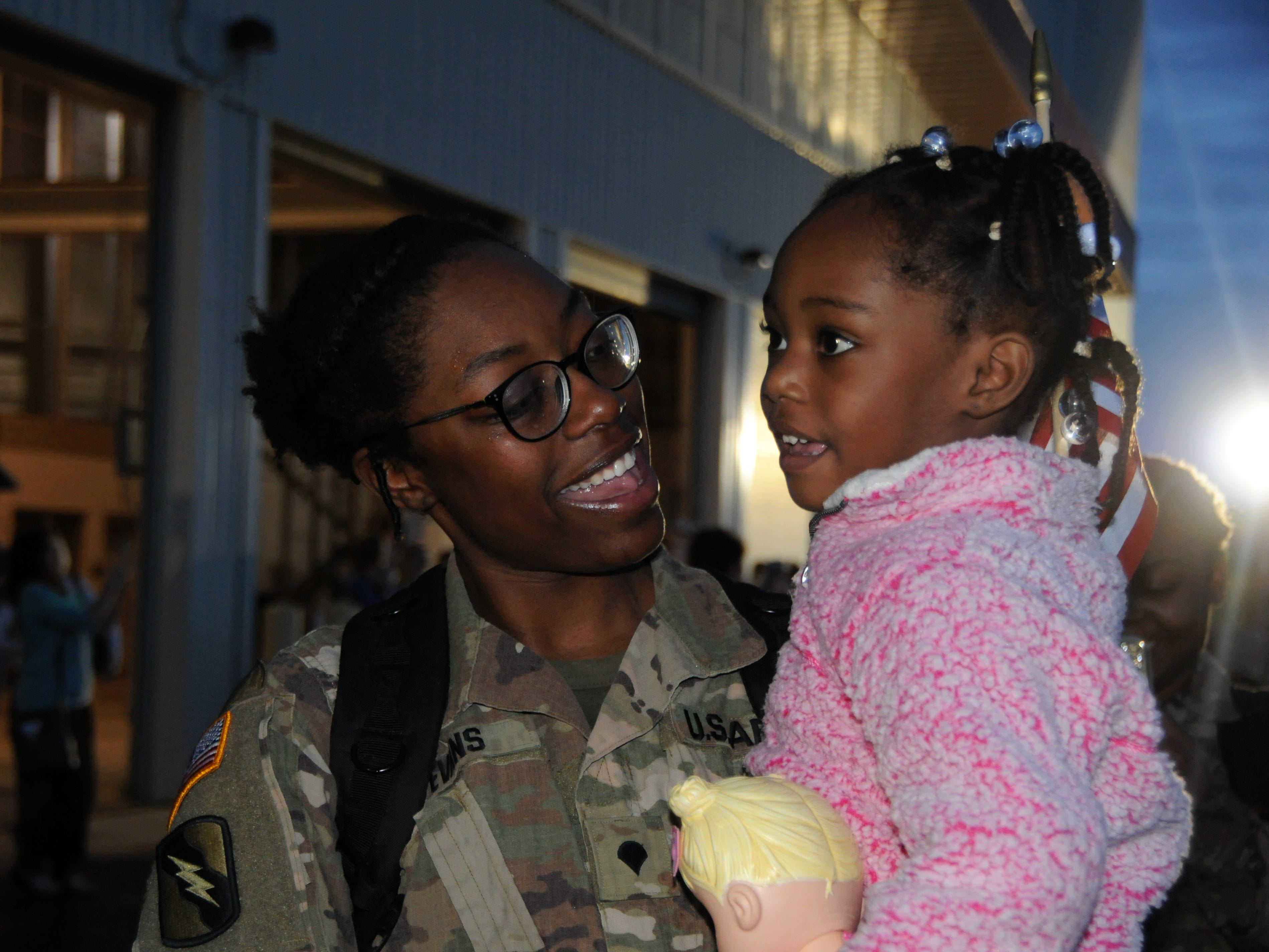 Spc. Lecourtney Evans, of Jackson, greets her daughter Rylei at Thompson Field in Flowood, Miss., Feb. 27, 2019. Evans, was part of a contingent of the Mississippi Army National Guard's 155th Armored Brigade Combat Team returning home after serving in Kuwait in support of Operation Spartan Shield for approximately one year.