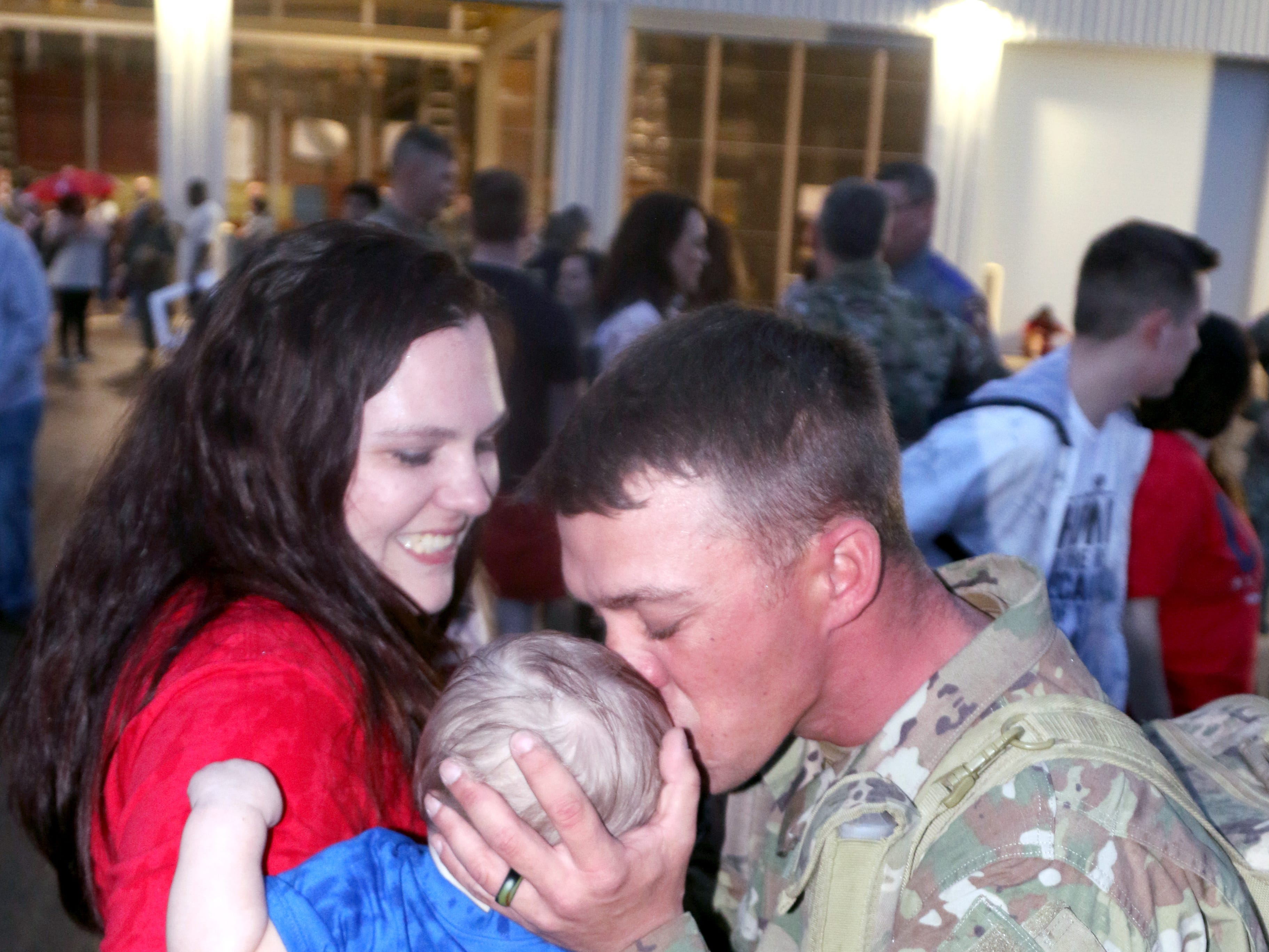 Staff Sgt. Carl Tate, with the 106th Brigade Support Battalion, greets his wife, Rebekah, and son, Kevin, at Thompson Field in Flowood, Mississippi, Feb. 27, 2019. Tate, of Bogue Chitto, was part of a contingent of the Mississippi Army National Guard's 155th Armored Brigade Combat Team returning home after serving in Kuwait in support of Operation Spartan Shield for approximately one year.