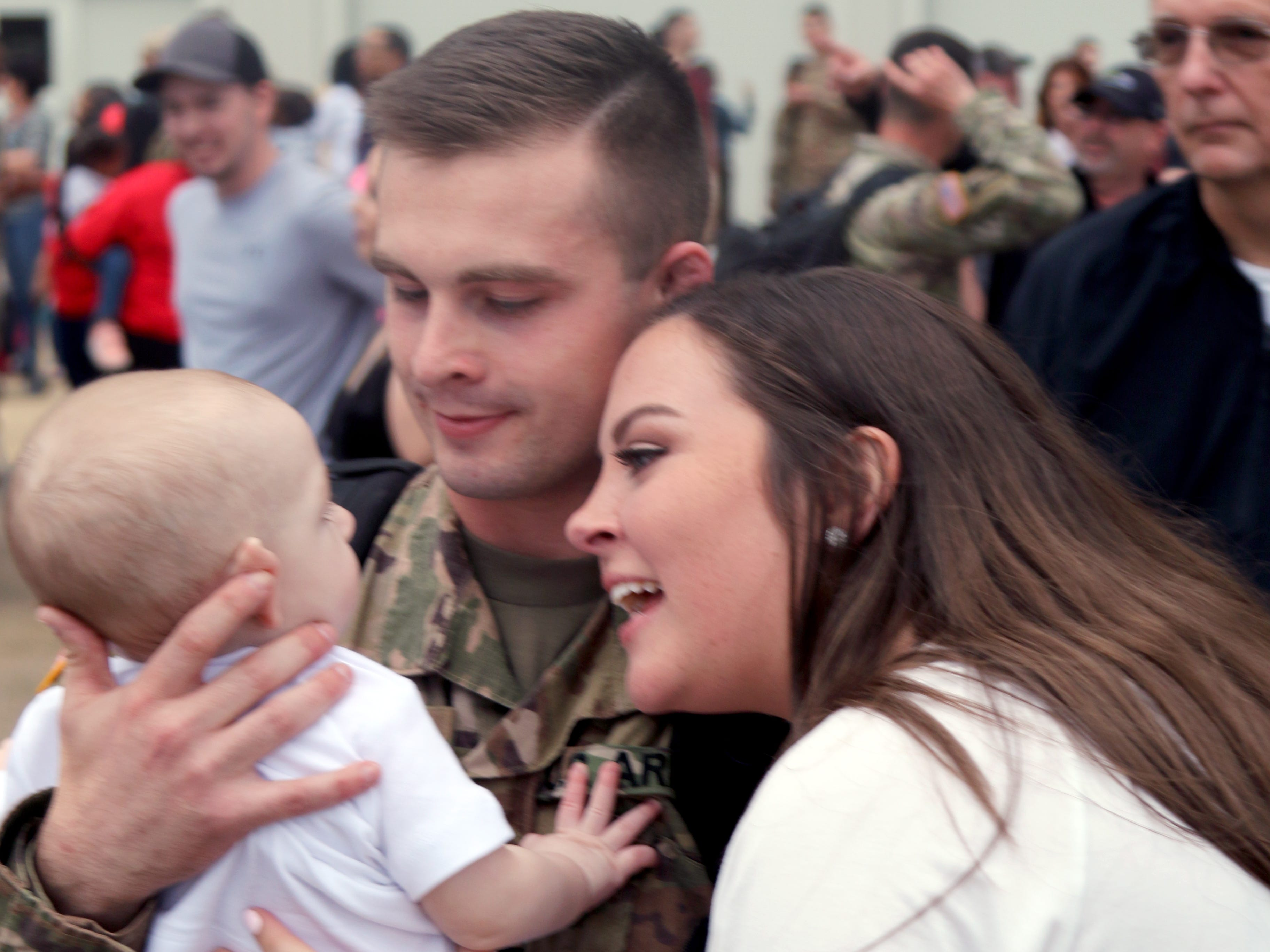 Spc. Robert Daniel Hankins, of 1st Battalion, 98th Cavalry Regiment, reunites with his wife, Kala, and son, Weston, at Thompson Field in Flowood, Mississippi, Feb. 27, 2019. Hankins, of Tupelo, was part of a contingent of the Mississippi Army National Guard's 155th Armored Brigade Combat Team returning home after serving in Kuwait in support of Operation Spartan Shield.