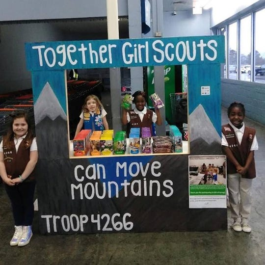 Here, girls from Troop 4266, a Flowood-area troop, are selling Girl Scout cookies at a local Wal-Mart.