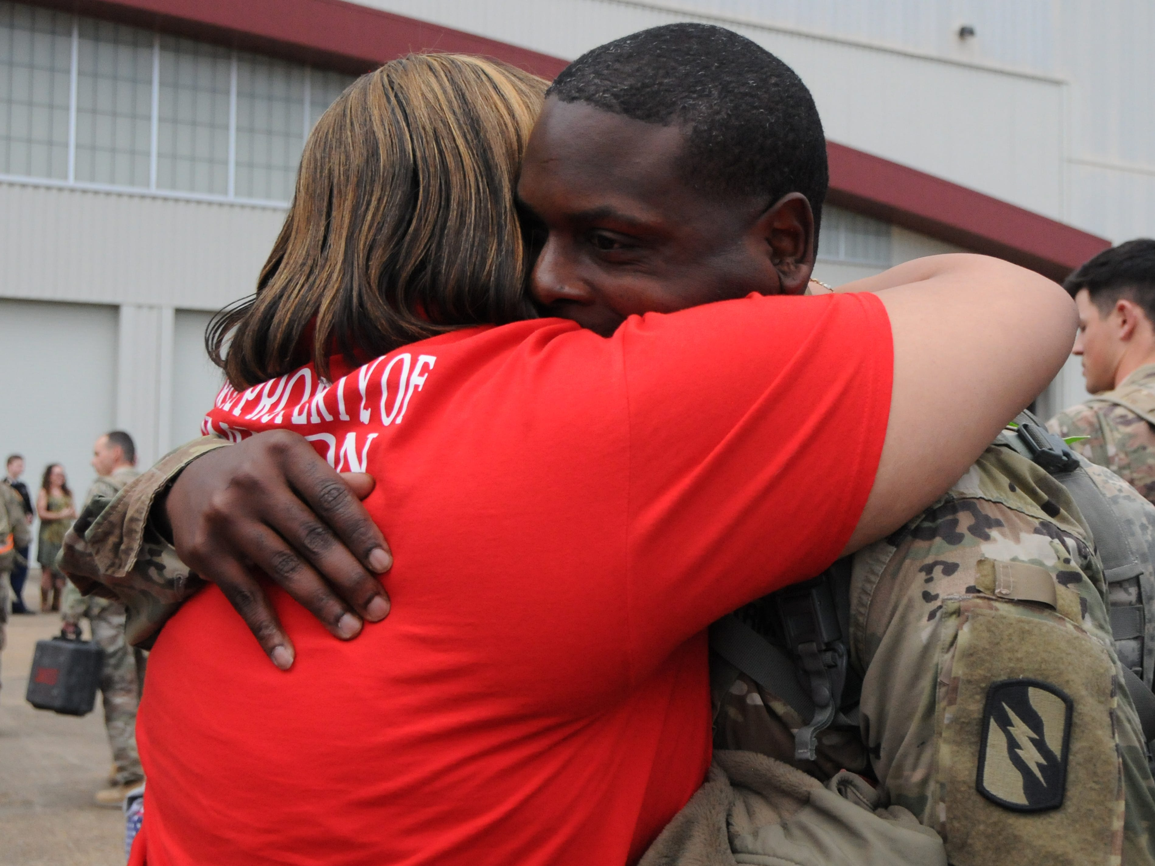 Spc. Earnest Jimison, of DeKalb, greets a loved one at Thompson Field in Flowood, Miss., Feb. 27, 2019. Jimison, was part of a contingent of the Mississippi Army National Guard's 155th Armored Brigade Combat Team returning home after serving in Kuwait in support of Operation Spartan Shield for approximately one year.