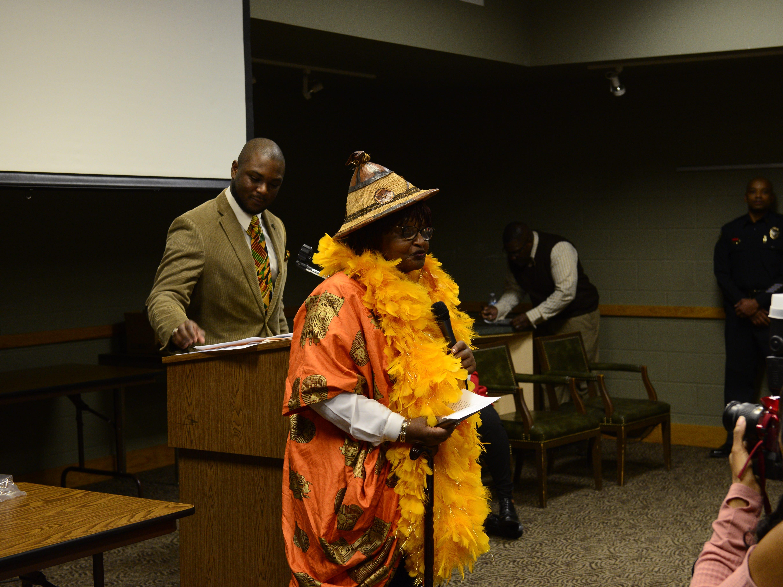 Brenda Monroe Moss accepts her award at the Jackson-Madison County Library in Jackson, Tenn. Feb. 27, 2019