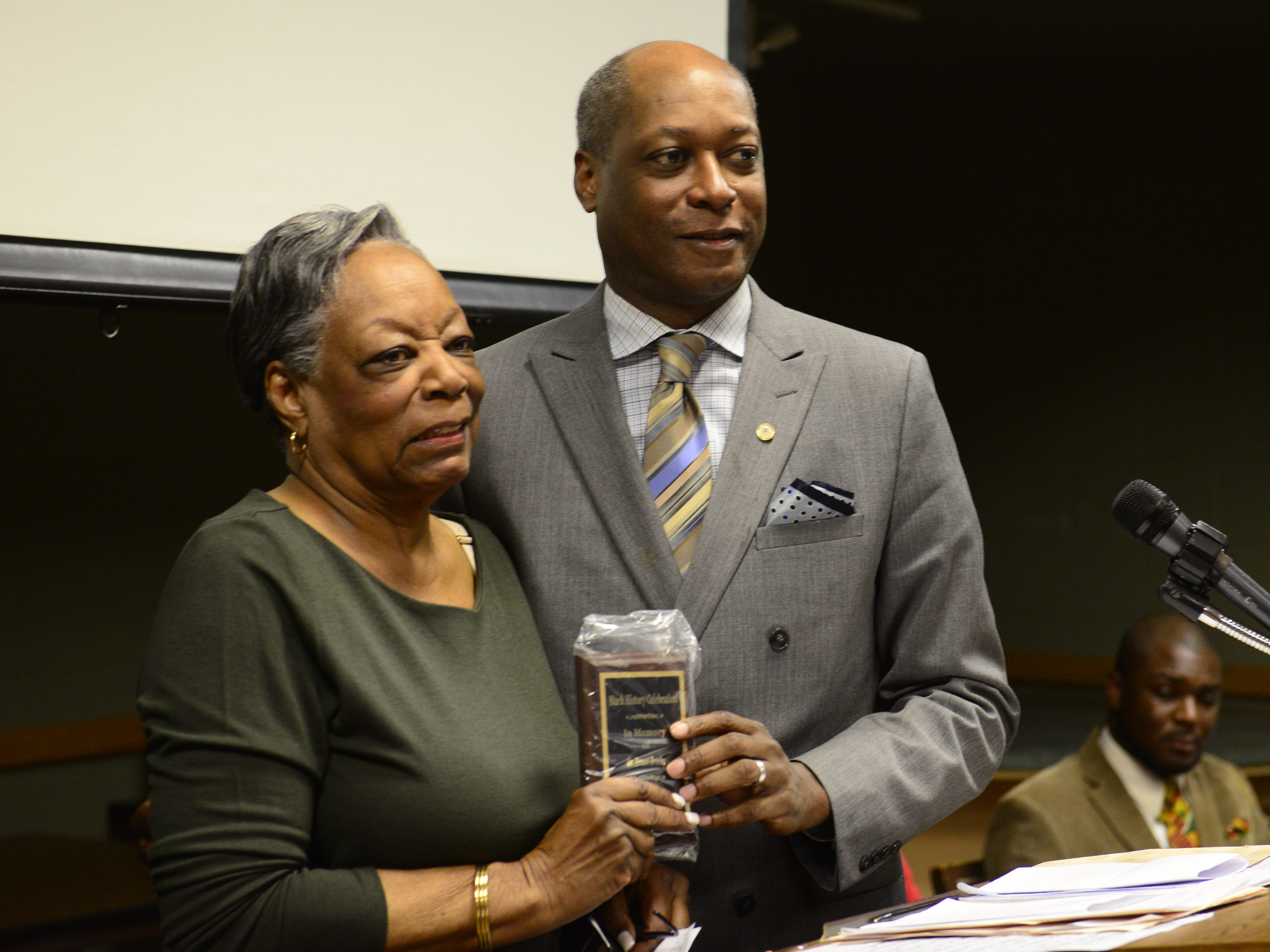 Ernest Brooks II along with is mother Dr. Patricia Brooks accept the an award in honor of his father Ernest Brooks at the Jackson-Madison County Library in Jackson, Tenn. Feb. 27, 2019