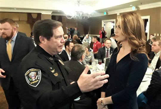 Knox County Sheriff Tom Spangler speaks with moderator Amanda Hara before the program.