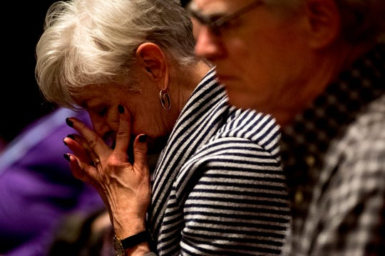 A church member wipes her face during a gathering of fellowship and prayer at Church Street United Methodist Church in Knoxville on Feb. 27, 2019. Church members gathered to reflect on the United Methodist Church's vote to uphold a ban on LGBTQ rights.