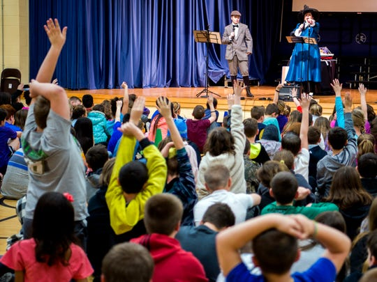 Students at Brickey-McCloud Elementary raise their hands to ask questions after performers from the Titanic Museum Attraction presented their educational program at the school Feb. 27, 2019.