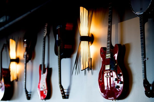 Guitars hang on the wall at country music singer Blake Shelton's Ole Red restaurant in Gatlinburg, Tennessee on Wednesday, February 27, 2019. The $9 million venue, which features food, drink and live musical performances on a fully-outfitted stage, will have a soft opening March 4.