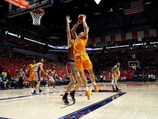 Tennessee forward Grant Williams (2) leans into a Mississippi player as he shoots at the basket during the first half of an NCAA college basketball game in Oxford, Miss., Wednesday, Feb. 27, 2019. Tennessee won 73-71. (AP Photo/Rogelio V. Solis)