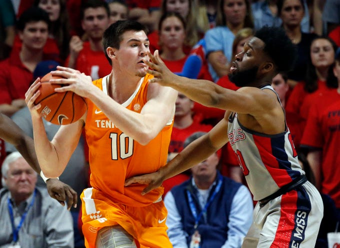Tennessee forward John Fulkerson (10) looks for an open teammate while guarded by Mississippi guard D.C. Davis (20) during the second half of an NCAA college basketball game in Oxford, Miss., Wednesday, Feb. 27, 2019. Tennessee won 73-71. (AP Photo/Rogelio V. Solis)