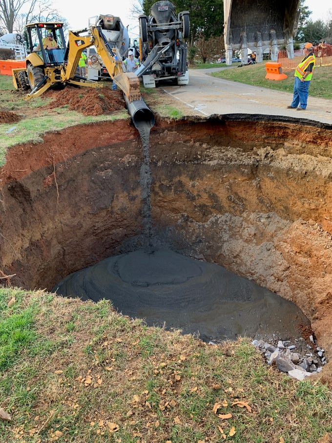 Knox County Public Works repairs a massive sinkhole on Greenwell Road in North Knox County.
