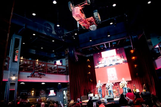 The main seating area features a good view of the stage as well as an old Farmall tractor hanging from the ceiling at country music singer Blake Shelton's Ole Red restaurant in Gatlinburg, Tennessee on Wednesday, February 27, 2019. The $9 million venue, which features food, drink and live musical performances on a fully-outfitted stage, will have a soft opening March 4.