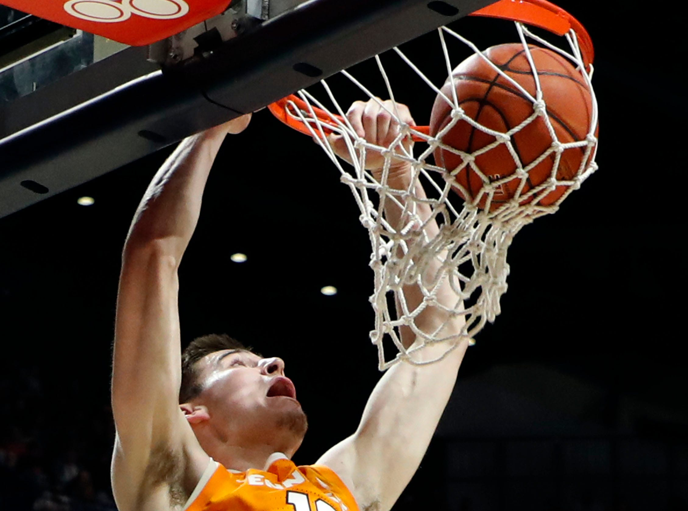 Tennessee forward John Fulkerson (10) watches his dunk go through the net against Mississippi during the first half of an NCAA college basketball game in Oxford, Miss., Wednesday, Feb. 27, 2019. (AP Photo/Rogelio V. Solis)
