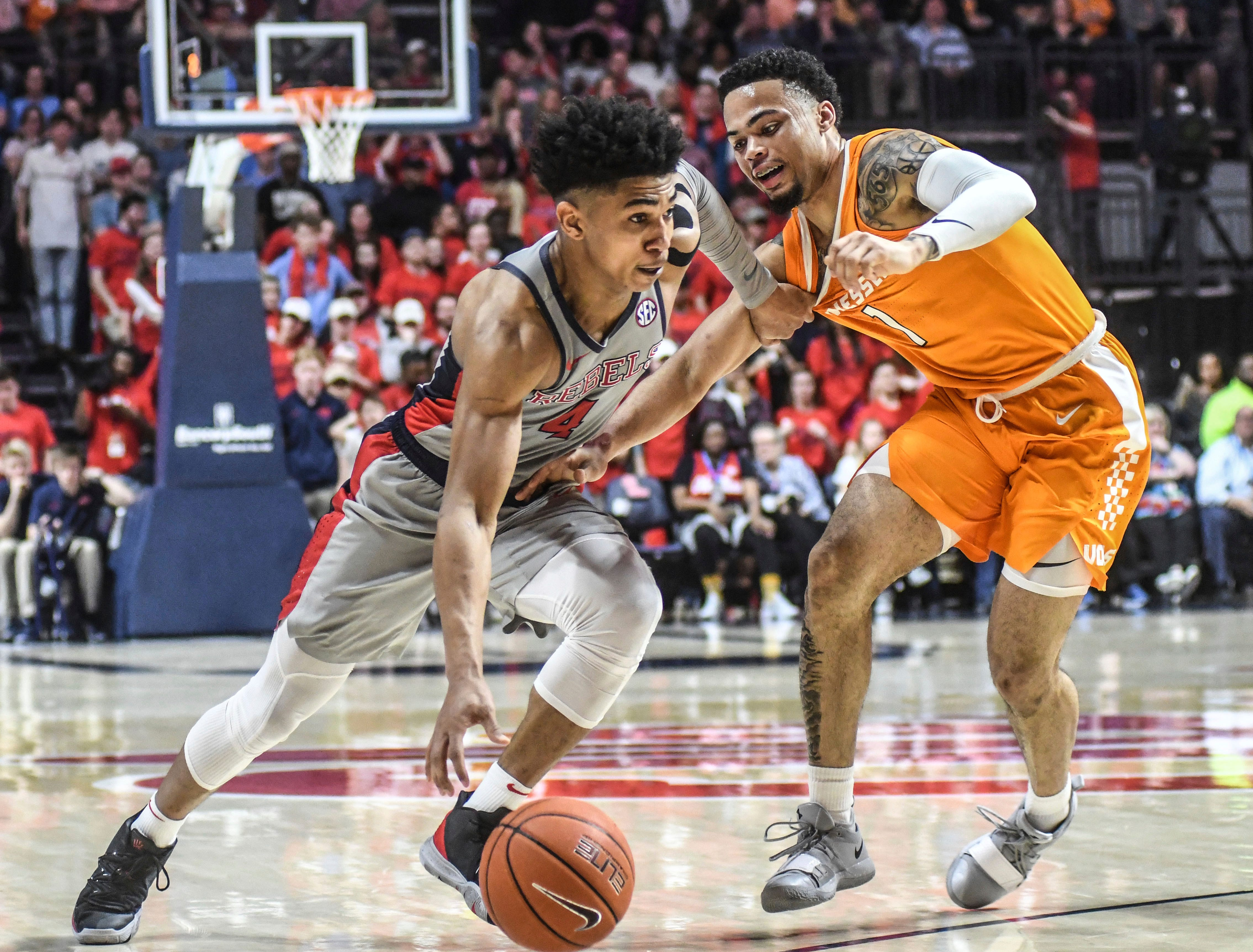 Mississippi guard Breein Tyree (4) drives against Tennessee's Lamonte' Turner (1) during the first half of an NCAA college basketball game, Wednesday, Feb. 27, 2019 in Oxford, Miss. (Bruce Newman/The Oxford Eagle via AP)