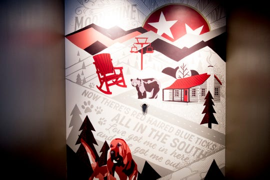 Art tying together the Smoky Mountains and Ole Red hangs on the wall at country music singer Blake Shelton's Ole Red restaurant in Gatlinburg, Tennessee on Wednesday, February 27, 2019. The $9 million venue, which features food, drink and live musical performances on a fully-outfitted stage, will have a soft opening March 4.