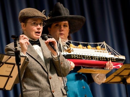 Lauren Trask, performing as Titanic passenger Frankie Goldsmith, answers a question as Jodi Justus, as Molly Brown, holds a Titanic model during the Titanic Museum Attraction's educational program Feb. 27, 2019.