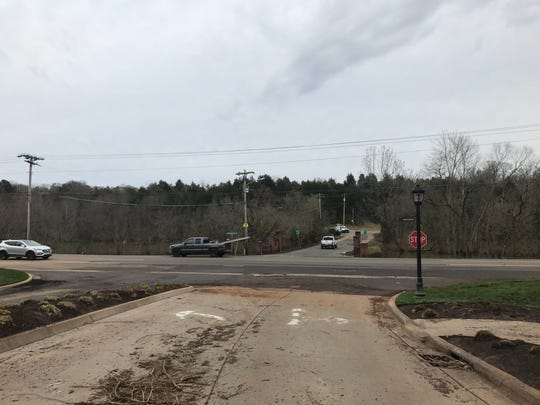 Northshore Drive at Whittington Creek and Scott Lane was clear and dry for traffic Thursday. Muddy roads and sticks were reminders that the intersection had been a flooded pond during the flood.