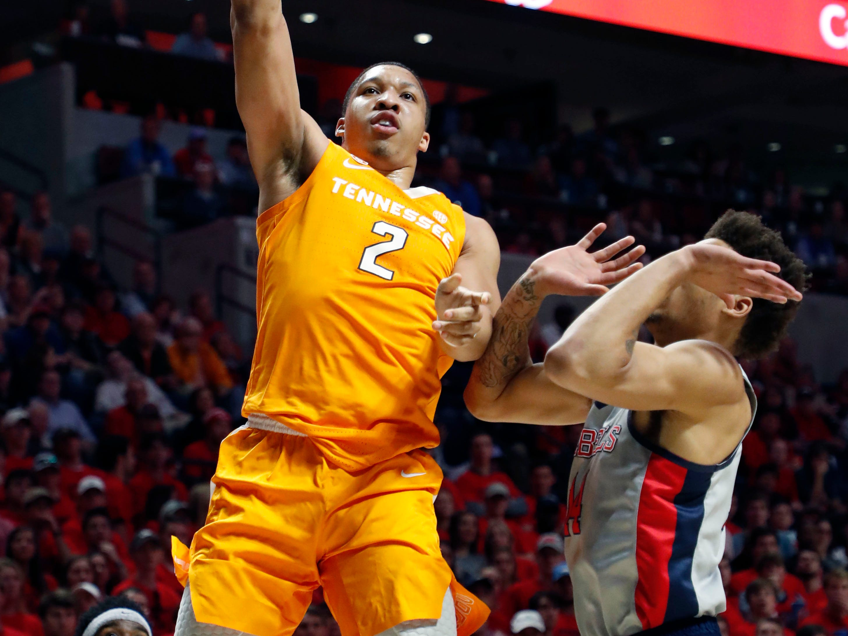 Tennessee forward Grant Williams (2) shoots over a Mississippi defender during the first half of an NCAA college basketball game in Oxford, Miss., Wednesday, Feb. 27, 2019. Tennessee won 73-71. (AP Photo/Rogelio V. Solis)