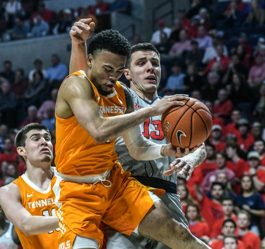 Mississippi center Dominik Olejniczak (13) fouls Tennessee's Lamonte' Turner (1) during the first half of an NCAA college basketball game, Wednesday, Feb. 27, 2019 in Oxford, Miss. (Bruce Newman/The Oxford Eagle via AP)