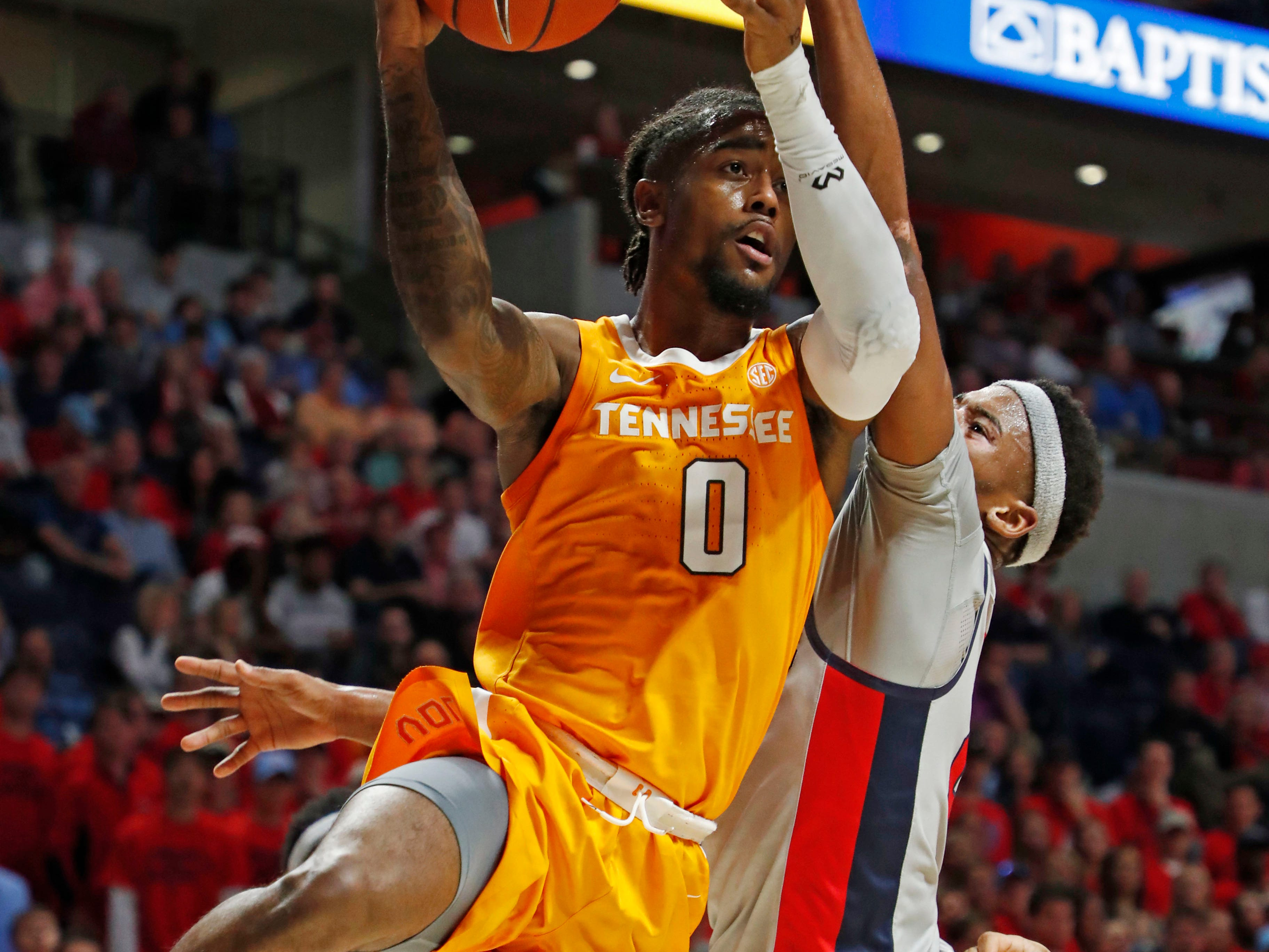 Tennessee guard Jordan Bone (0) forces a pass while Mississippi guard Devontae Shuler (2) reaches for the ball during the first half of an NCAA college basketball game in Oxford, Miss., Wednesday, Feb. 27, 2019. (AP Photo/Rogelio V. Solis)