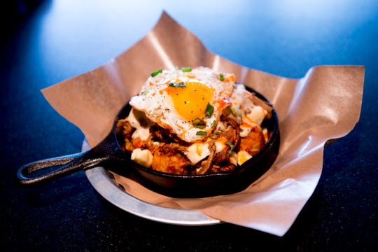 """The """"Southern Tater Tot Poutine"""" dish at country music singer Blake Shelton's Ole Red restaurant in Gatlinburg, Tennessee on Wednesday, February 27, 2019. The $9 million venue, which features food, drink and live musical performances on a fully-outfitted stage, will have a soft opening March 4."""