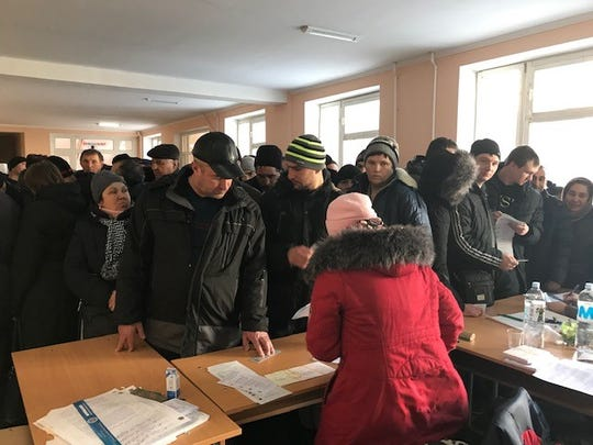 Voters line up in the country of Moldova, February 2019.