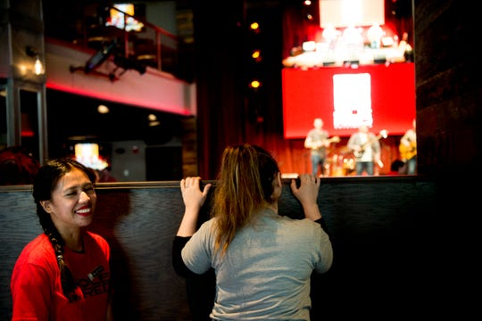 Waitresses peek at the stage at country music singer Blake Shelton's Ole Red restaurant in Gatlinburg, Tennessee on Wednesday, February 27, 2019. The $9 million venue, which features food, drink and live musical performances on a fully-outfitted stage, will have a soft opening March 4.