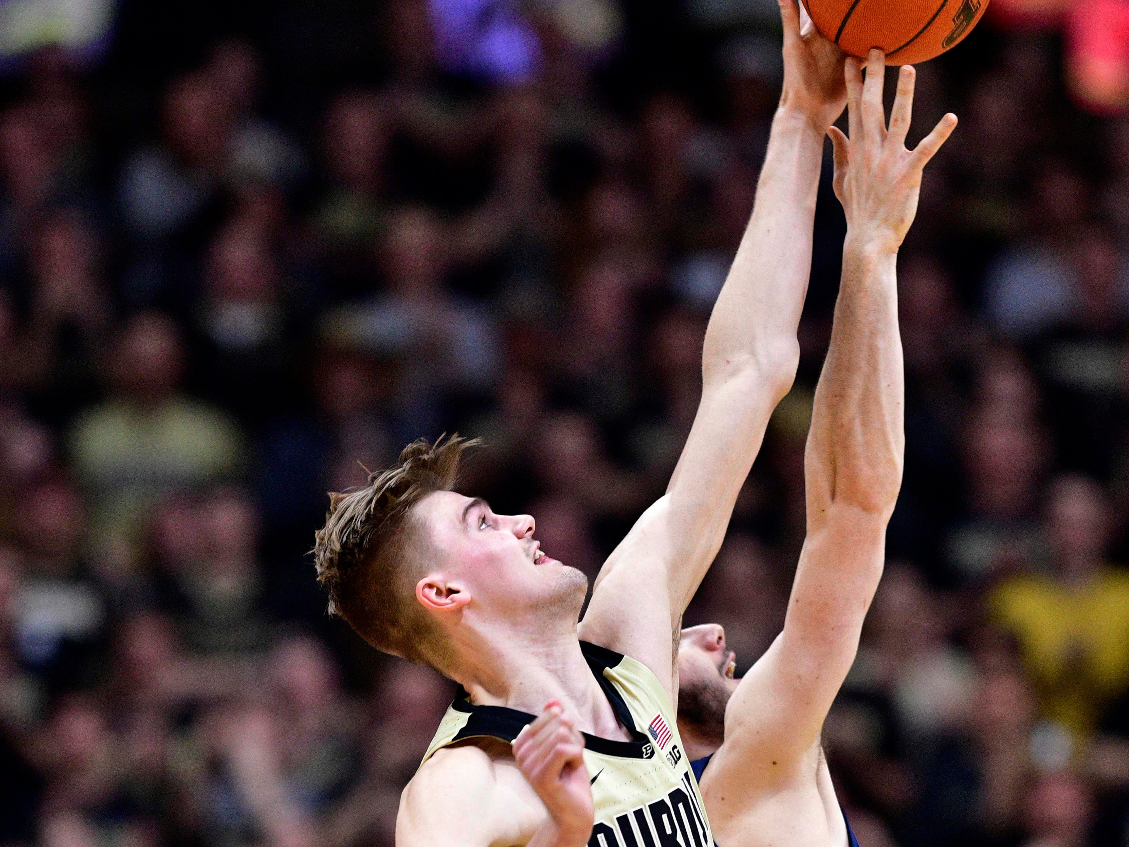 Feb 27, 2019; West Lafayette, IN, USA; Purdue Boilermakers center Matt Haarms (32) wins the tip off at the beginning of the game against the Illinois Fighting Illini at Mackey Arena. Mandatory Credit: Marc Lebryk-USA TODAY Sports