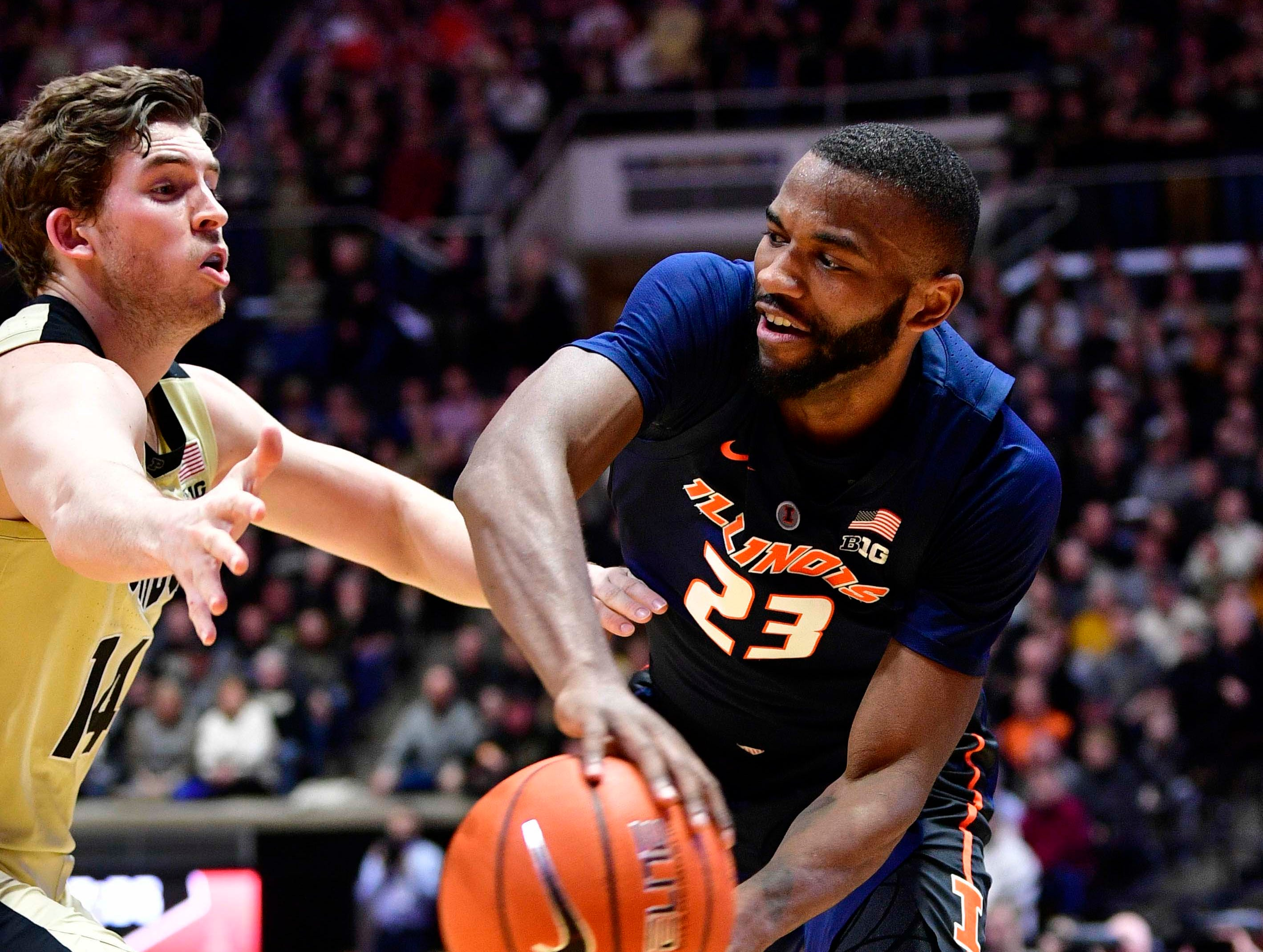 Feb 27, 2019; West Lafayette, IN, USA; Illinois Fighting Illini guard Aaron Jordan (23) looks for an open teammate against Purdue Boilermakers guard Ryan Cline (14) during the first half of the game at Mackey Arena. Mandatory Credit: Marc Lebryk-USA TODAY Sports